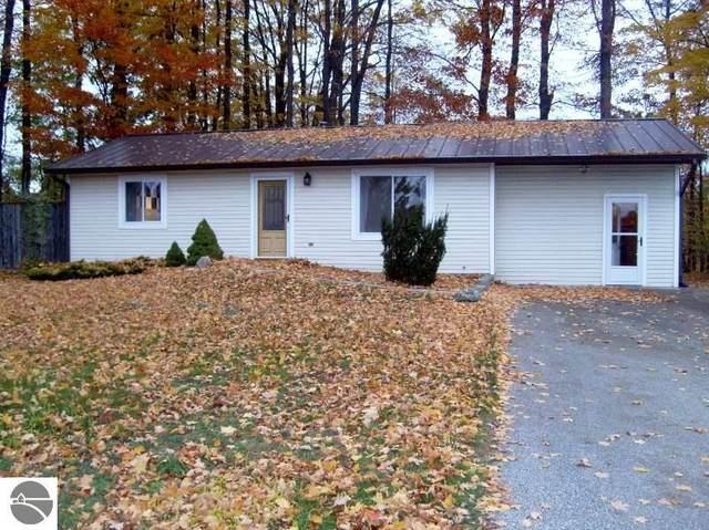 7426 Scotchwood Lane, Grawn, MI 49637 (MLS #1881548) :: Michigan LifeStyle Homes Group
