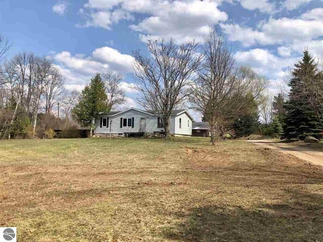 8821 Cherry Avenue, Rapid City, MI 49676 (MLS #1885555) :: Michigan LifeStyle Homes Group