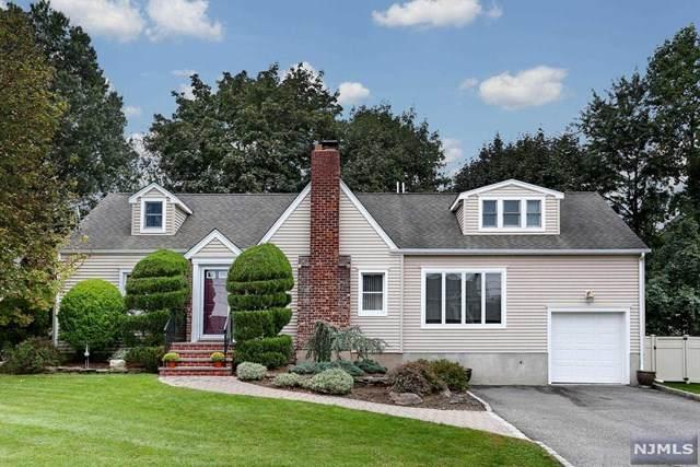 61 Huntting Drive, Dumont, NJ 07628 (MLS #21041537) :: The Sikora Group