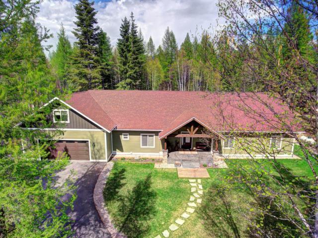 13744 Great Bear Loop, Bigfork, MT 59911 (MLS #21905705) :: Brett Kelly Group, Performance Real Estate