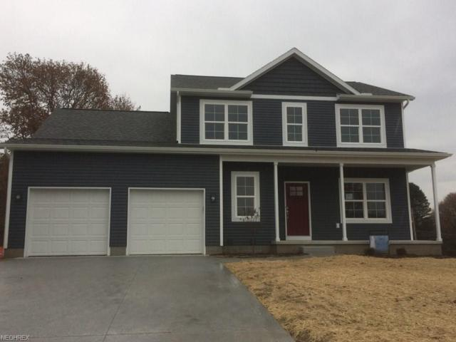 10564 Rabbit Cove Cir NW, Uniontown, OH 44685 (MLS #3960593) :: The Kaszyca Team