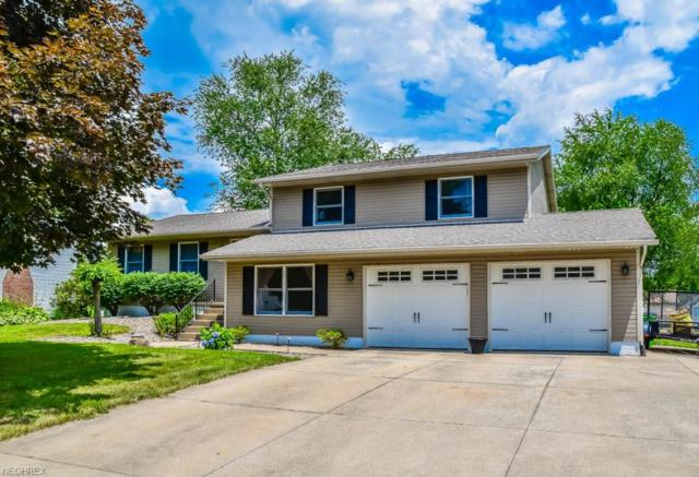 1064 Cayuga Trl SW, Hartville, OH 44632 (MLS #4018913) :: RE/MAX Trends Realty
