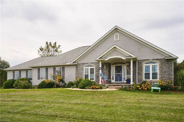8106 Stallion Rd NW, Magnolia, OH 44643 (MLS #4127787) :: The Crockett Team, Howard Hanna