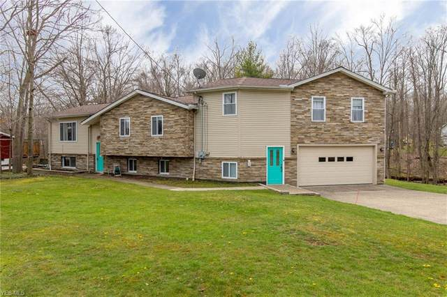 7667 Maple Grove Drive, Chesterland, OH 44026 (MLS #4182460) :: The Holly Ritchie Team