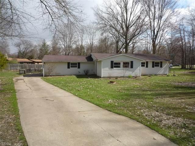 1064 Thistleridge Drive, Macedonia, OH 44056 (MLS #4194012) :: The Crockett Team, Howard Hanna