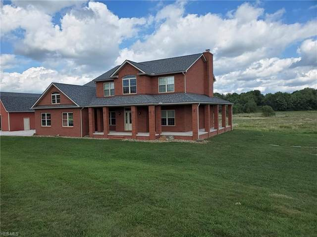 11094 Wolf Avenue NE, Hartville, OH 44632 (MLS #4220540) :: RE/MAX Trends Realty