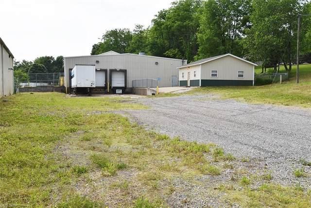 3213 Magnolia Road NW, Magnolia, OH 44643 (MLS #4289636) :: TG Real Estate