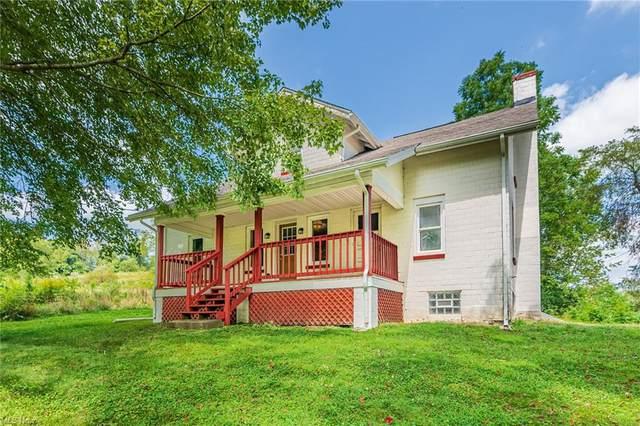 1032 Hartwood Road NW, Magnolia, OH 44643 (MLS #4307919) :: TG Real Estate
