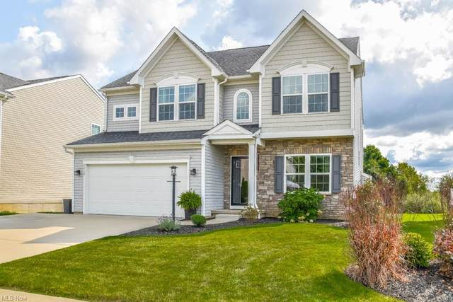 7112 Emerald Bay Avenue NW, Canal Fulton, OH 44614 (MLS #4319744) :: The Holden Agency