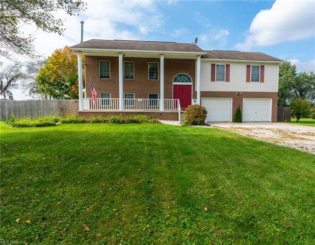 11667 Basswood Avenue NW, Uniontown, OH 44685 (MLS #4323329) :: Tammy Grogan and Associates at Keller Williams Chervenic Realty