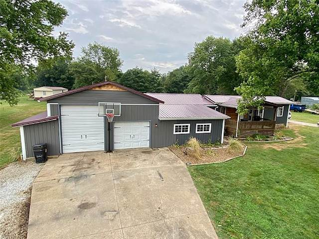 9094 Wilco Drive NW, Malvern, OH 44644 (MLS #4306610) :: The Holly Ritchie Team