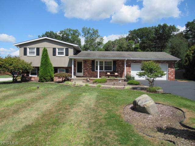 1135 Canyon Street NE, Uniontown, OH 44685 (MLS #4135151) :: RE/MAX Trends Realty