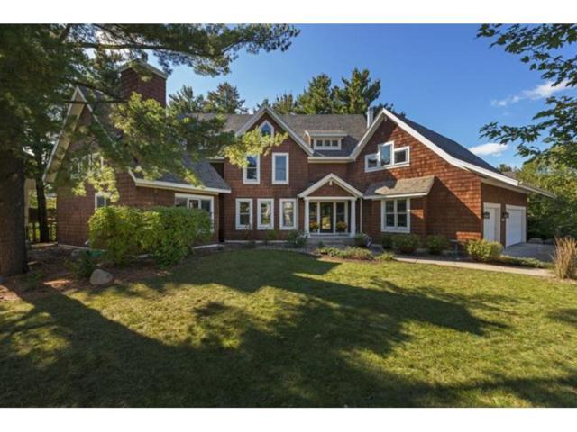 10055 Powers Lake Trail, Woodbury, MN 55129 (#4919280) :: Olsen Real Estate Group