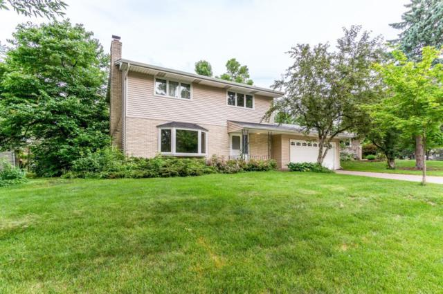 1448 Pinewood Drive, Woodbury, MN 55125 (#4939306) :: The Preferred Home Team