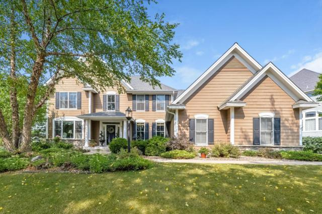 8772 Springwood Drive, Woodbury, MN 55125 (#4997457) :: The Snyder Team