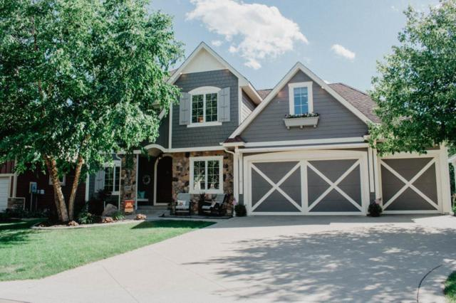 10685 Watersedge Lane, Woodbury, MN 55129 (#5003173) :: The Hergenrother Group North Suburban