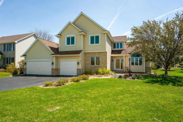 10271 Raleigh Road, Woodbury, MN 55129 (#5226198) :: The Preferred Home Team