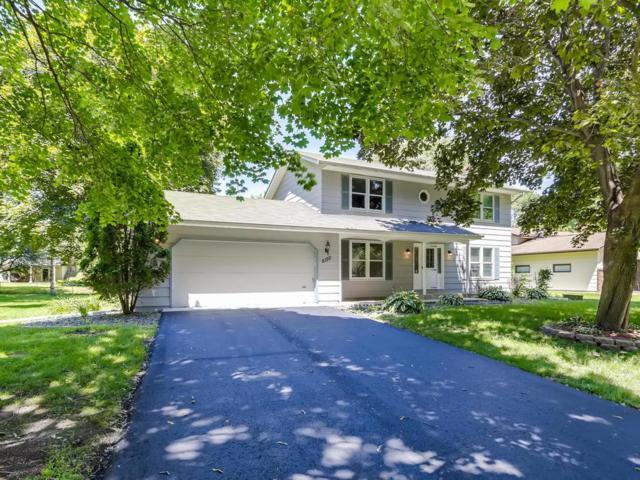 6150 Upper 44th Street N, Oakdale, MN 55128 (#5263028) :: Olsen Real Estate Group