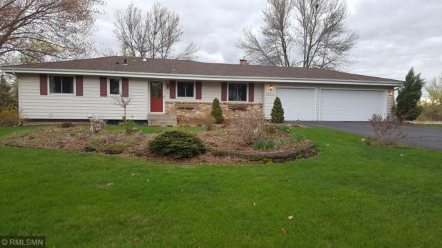 26435 Edgewood Road, Shorewood, MN 55331 (#5149446) :: The Odd Couple Team