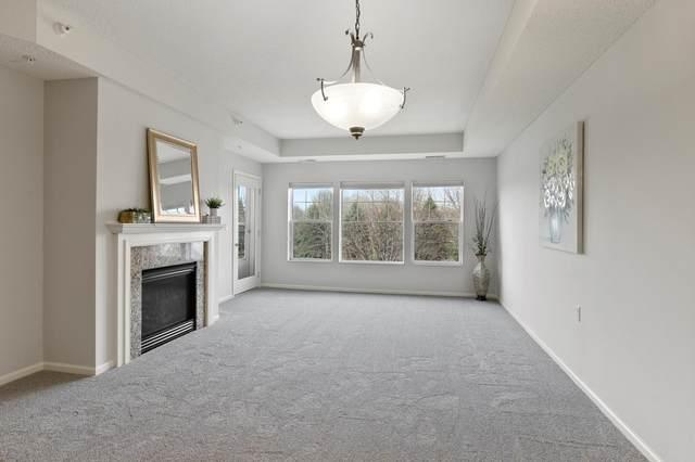 3800 85th Avenue N #217, Brooklyn Park, MN 55443 (#5741203) :: The Janetkhan Group