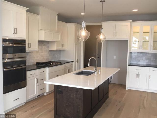 9162 Red Oak Trail, Woodbury, MN 55129 (#4999628) :: Olsen Real Estate Group