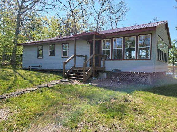 54 Great Wood, Beaver Twp, WI 54889 (#5761424) :: Bos Realty Group