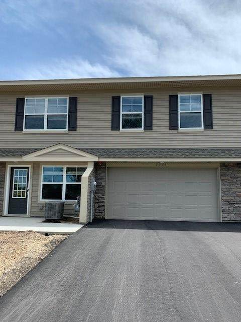4903 Equine Trail, Woodbury, MN 55129 (#5572629) :: Holz Group