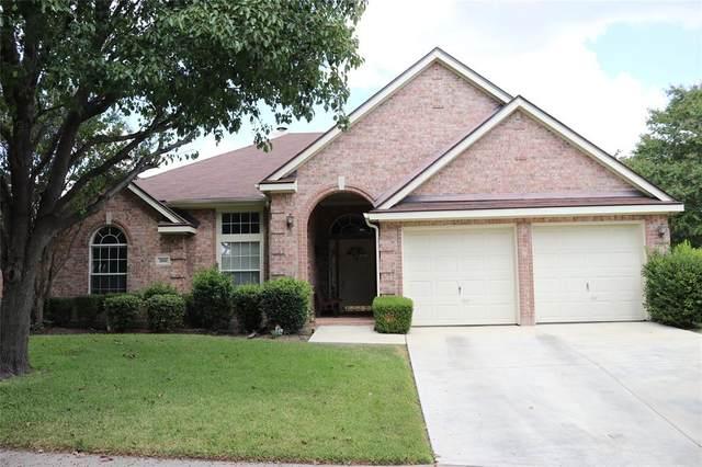 7050 Buena Vista Drive, Fort Worth, TX 76137 (MLS #14440234) :: The Kimberly Davis Group