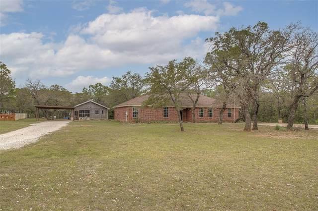 7731 Wolf Hollow, Millsap, TX 76066 (MLS #14561869) :: Wood Real Estate Group
