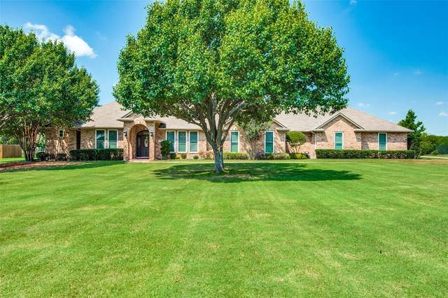 5711 Pinnacle Circle, Sachse, TX 75048 (MLS #14654340) :: Craig Properties Group