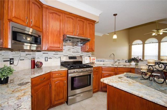 9301 Woodlake Drive, Rowlett, TX 75088 (MLS #13874530) :: Team Hodnett