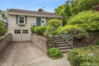 4031 33rd Ave W, Seattle, WA 98199 (#1113541) :: Alchemy Real Estate