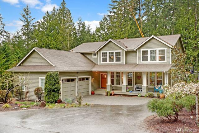 5774 NE Ravenswood Ct, Bainbridge Island, WA 98110 (#1099533) :: Ben Kinney Real Estate Team