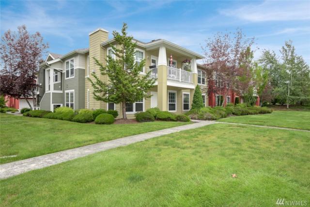 22621 NE Alder Crest Dr #101, Redmond, WA 98053 (#1135970) :: Ben Kinney Real Estate Team