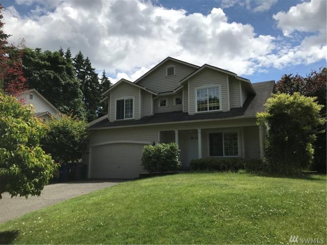 12023 NE 100th Place, Kirkland, WA 98033 (#1142833) :: Ben Kinney Real Estate Team