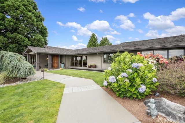 8670 NE 17th St, Clyde Hill, WA 98004 (#1147121) :: Alchemy Real Estate