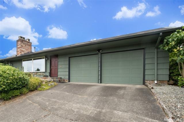 8702 Jones Ave NW, Seattle, WA 98117 (#1147527) :: Ben Kinney Real Estate Team