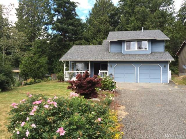7700 NE Seawind Ave, Poulsbo, WA 98370 (#1147706) :: Better Homes and Gardens Real Estate McKenzie Group