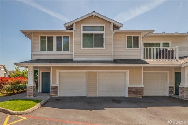 21914 42nd Ave S #101, Kent, WA 98032 (#1153376) :: Ben Kinney Real Estate Team