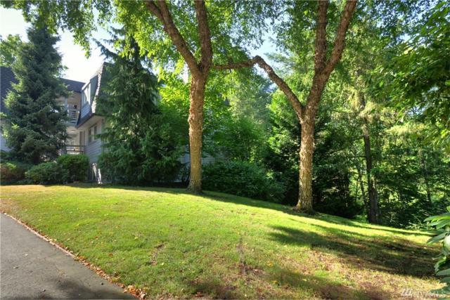 9824 NE 142nd Place D202, Kirkland, WA 98034 (#1159474) :: Real Estate Solutions Group