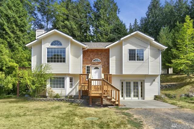 8320 NE Beachwood Ave, Poulsbo, WA 98370 (#1178264) :: Better Homes and Gardens Real Estate McKenzie Group
