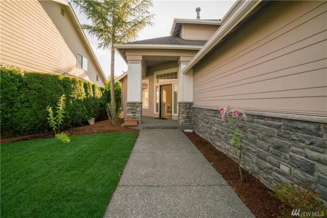 9911 225th Ave NE, Redmond, WA 98053 (#1178770) :: Carroll & Lions