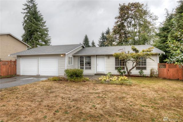 12521 SE 217th Place, Kent, WA 98031 (#1197145) :: Keller Williams - Shook Home Group