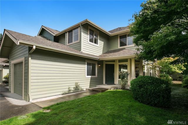 9128 161st Place NE #1404, Redmond, WA 98052 (#1197270) :: Ben Kinney Real Estate Team