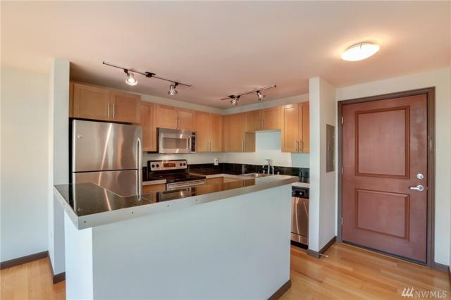 3661 Phinney Ave N #202, Seattle, WA 98103 (#1205605) :: Alchemy Real Estate