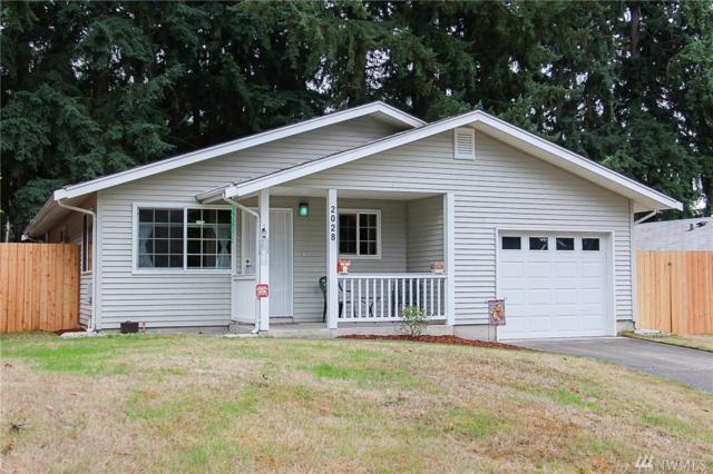 2028 E 59th St, Tacoma, WA 98404 (#1206372) :: Ben Kinney Real Estate Team