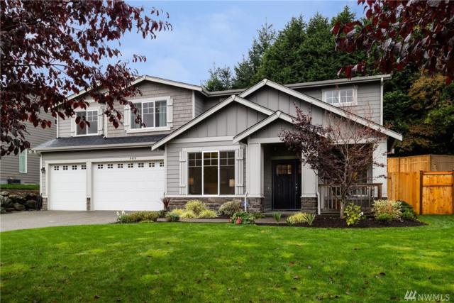 9415 117th Ave NE, Kirkland, WA 98033 (#1208375) :: Ben Kinney Real Estate Team