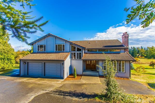 8815 Woodland Ave E, Puyallup, WA 98371 (#1208632) :: Ben Kinney Real Estate Team