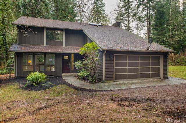6955 NE Hidden Cove Rd, Bainbridge Island, WA 98110 (#1222624) :: Better Homes and Gardens Real Estate McKenzie Group