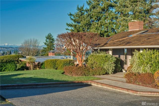 9020 NE 19th St, Clyde Hill, WA 98004 (#1234255) :: Alchemy Real Estate